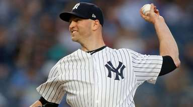Yankees pitcher J.A. Happ delivers in the first