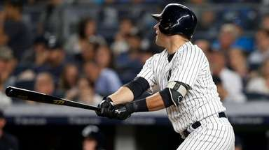 Yankees catcher Austin Romine follows through on a