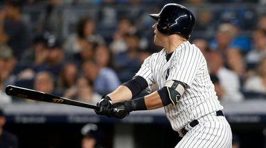 Yankees catcher Austin Romine follows through on a