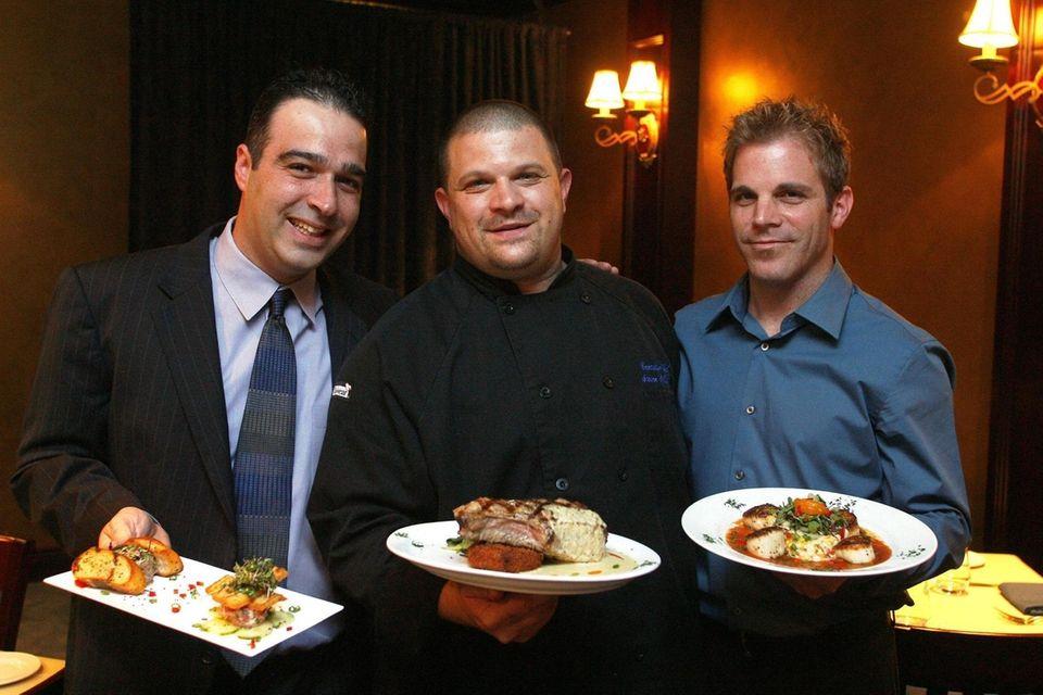 """Restaurant owner Luigi Alde holding the dish """"B&B"""