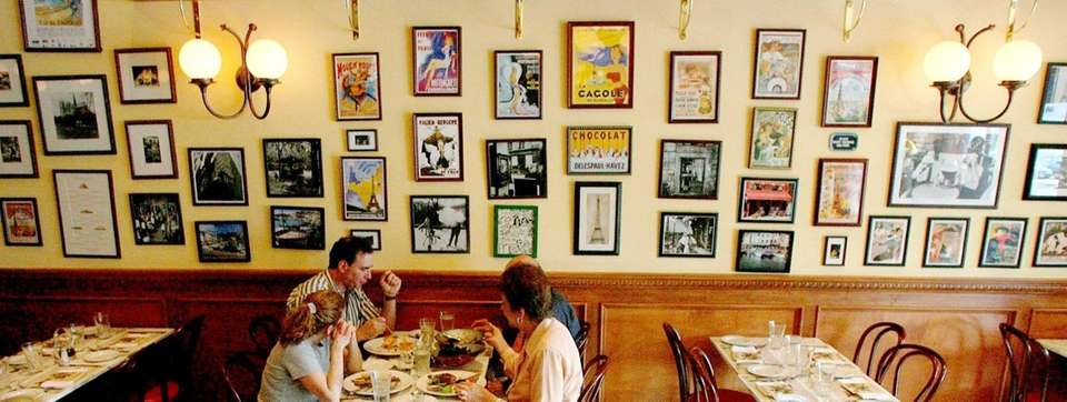 Patrons dine at Brasserie Cassis Bistro in Plainview,