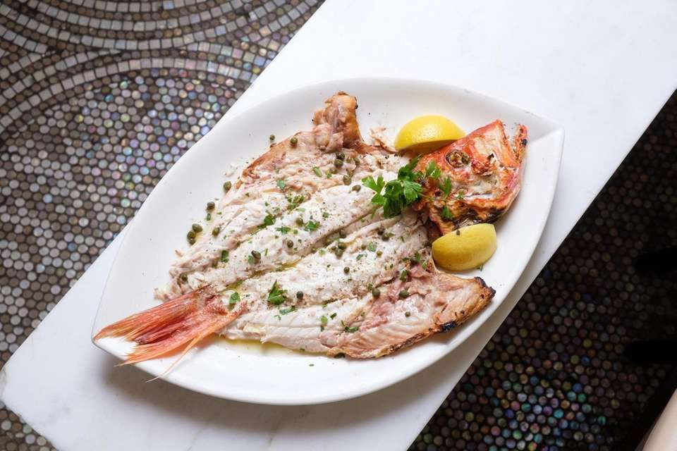Whole grilled Pink Snapper with lemon, olive oil,