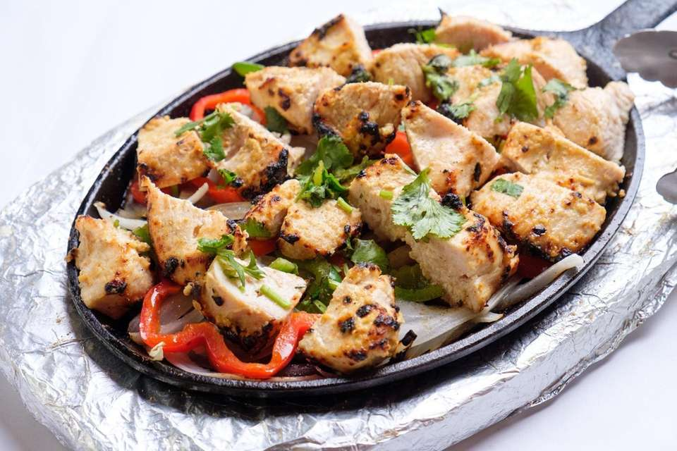 Malai Kebab, chicken marinated with cashew, sour cream,