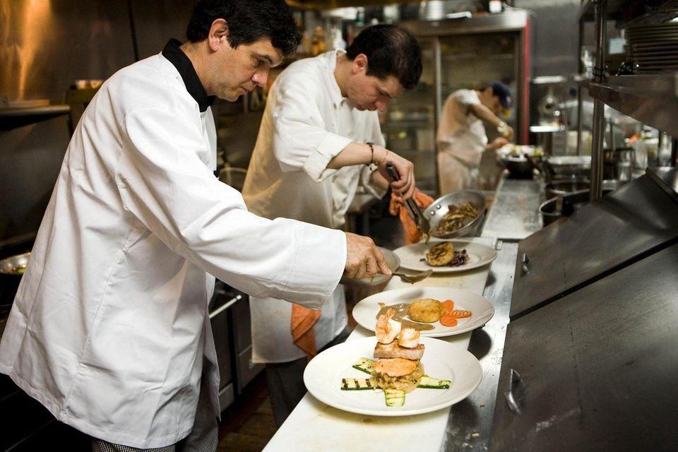 Chef Carlos M. Acevedo prepares a dish in