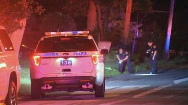 Police investigate the scene of a shooting early