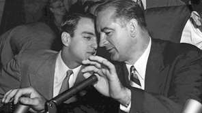 U.S. Sen. Joseph McCarthy, right, speaks to his