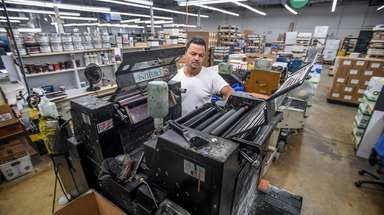 Employees at Unicorn Graphics in Garden City work