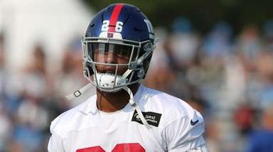Giants running back Saquon Barkley walks through a