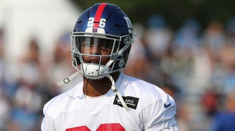 Giants running back Saquon Barkley walks through a