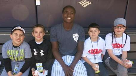 Yankees shortstop Didi Gregorius with Kidsday reporters, from