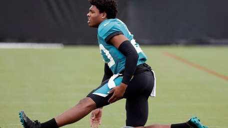 Jacksonville Jaguars cornerback Jalen Ramsey stretches out during