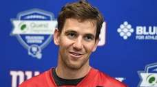 Giants quarterback Eli Manning, talking to reporters during