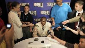 Kentucky's DeMarcus Cousins speaks to reporters during the