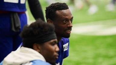Eli Apple of the Giants looks on during