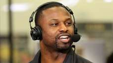 Former Jets linebacker Bart Scott speaks during an