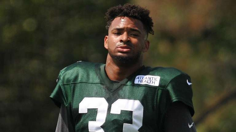 Jamal Adams of the Jets takes off his