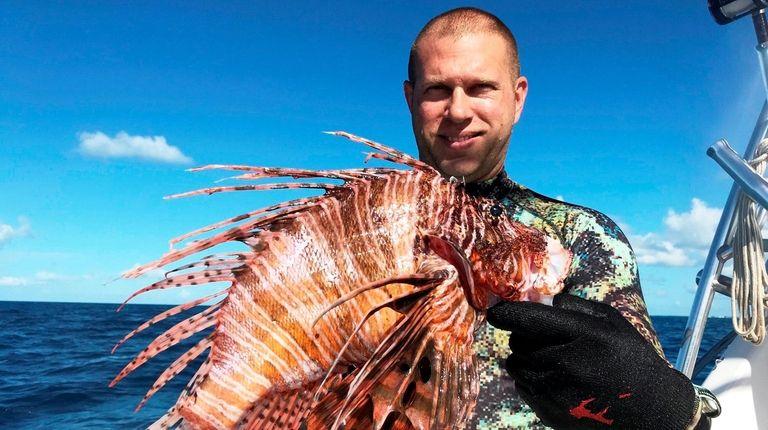 Timothy Blasko with record-setting lionfish.