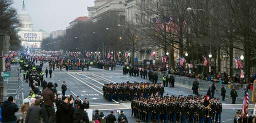 Military units participate in the inauguration parade from