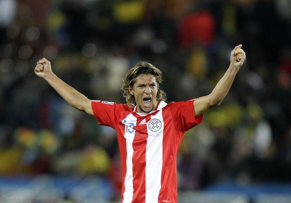 Paraguay's Enrique Vera celebrates at the end of