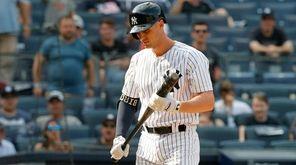 Greg Bird of the Yankees walks back to