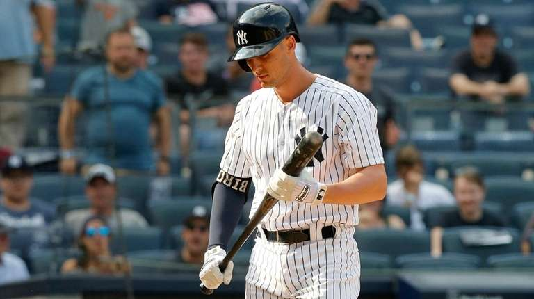 Greg Bird of the Yankees walks back to