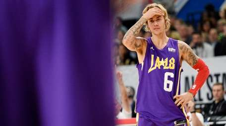 Justin Bieber reacts to a play during