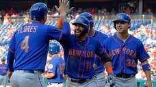 New York Mets' Jose Bautista, center, high-fives Wilmer