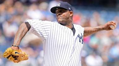 Yankees pitcher CC Sabathia delivers a pitch during