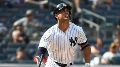 Giancarlo Stanton of the Yankees hits an RBI