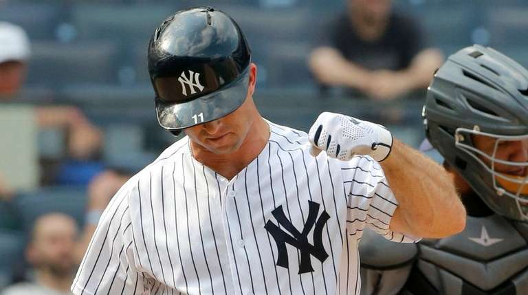 Yankees outfielder Brett Gardner reacts after striking out