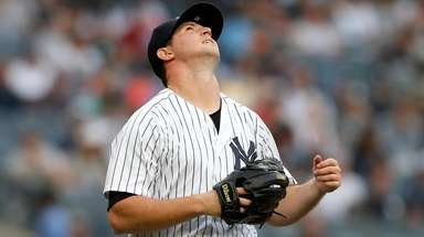Zach Britton of the Yankees reacts after giving
