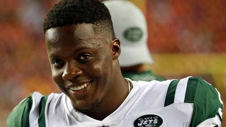 Jets quarterback Teddy Bridgewater smiles on the sidelines