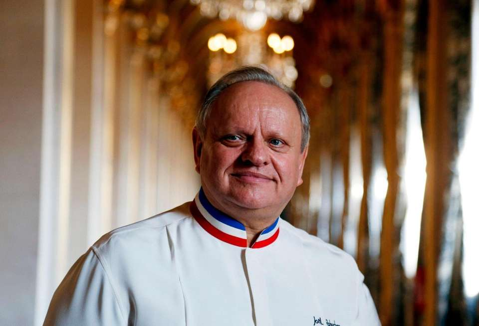 French chef Joel Robuchon poses in a corridor