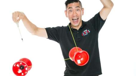Rob Lok juggles for the National Circus Project.