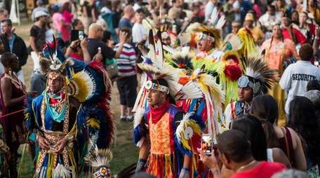 Shinnecocks and members of visiting tribes dance in
