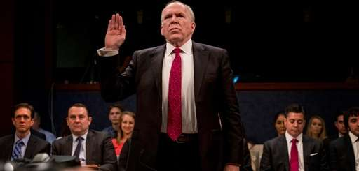 Former CIA Director John Brennan testifies before the