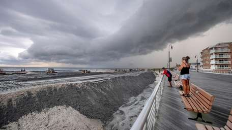 Heavy equipment moves sand to create dunes on