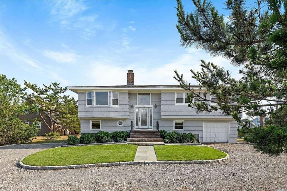 This Hampton Bays split-ranch includes four bedrooms and
