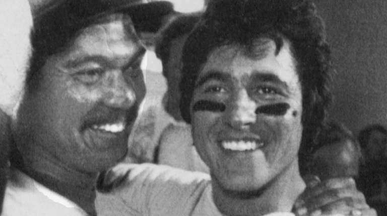 Bucky Dent, right, is embraced by Yankees