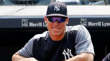Yankees outfielder Aaron Judge looks on from the