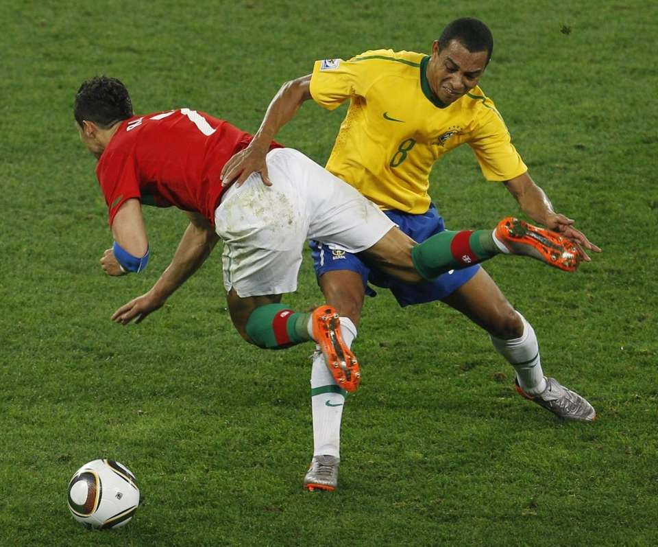 Brazil's Gilberto Silva, right, competes for the ball