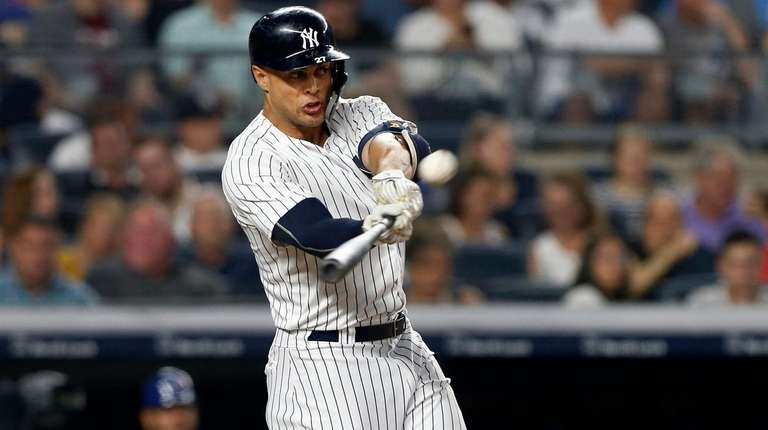 Giancarlo Stanton of the Yankees connects for a