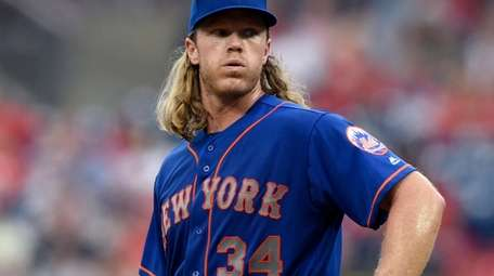 Mets starter Noah Syndergaard reacts after giving up