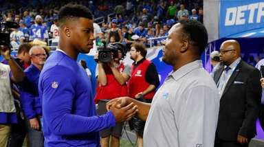 Giants running back Saquon Barkley, left, meets with