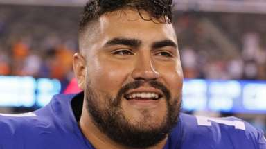 Giants guard Will Hernandez on the field following