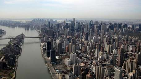 An aerial of Manhattan, the East River and