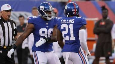 Giants defensive back Landon Collins is congratulated by