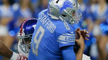 Lions quarterback Matthew Stafford is sacked by Giants