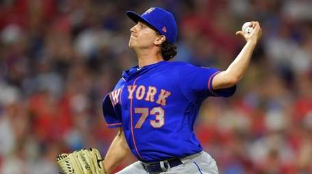 Daniel Zamora #73 of the Mets delivers a