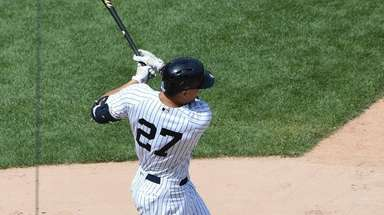 New York Yankees designated hitter Giancarlo Stanton follows